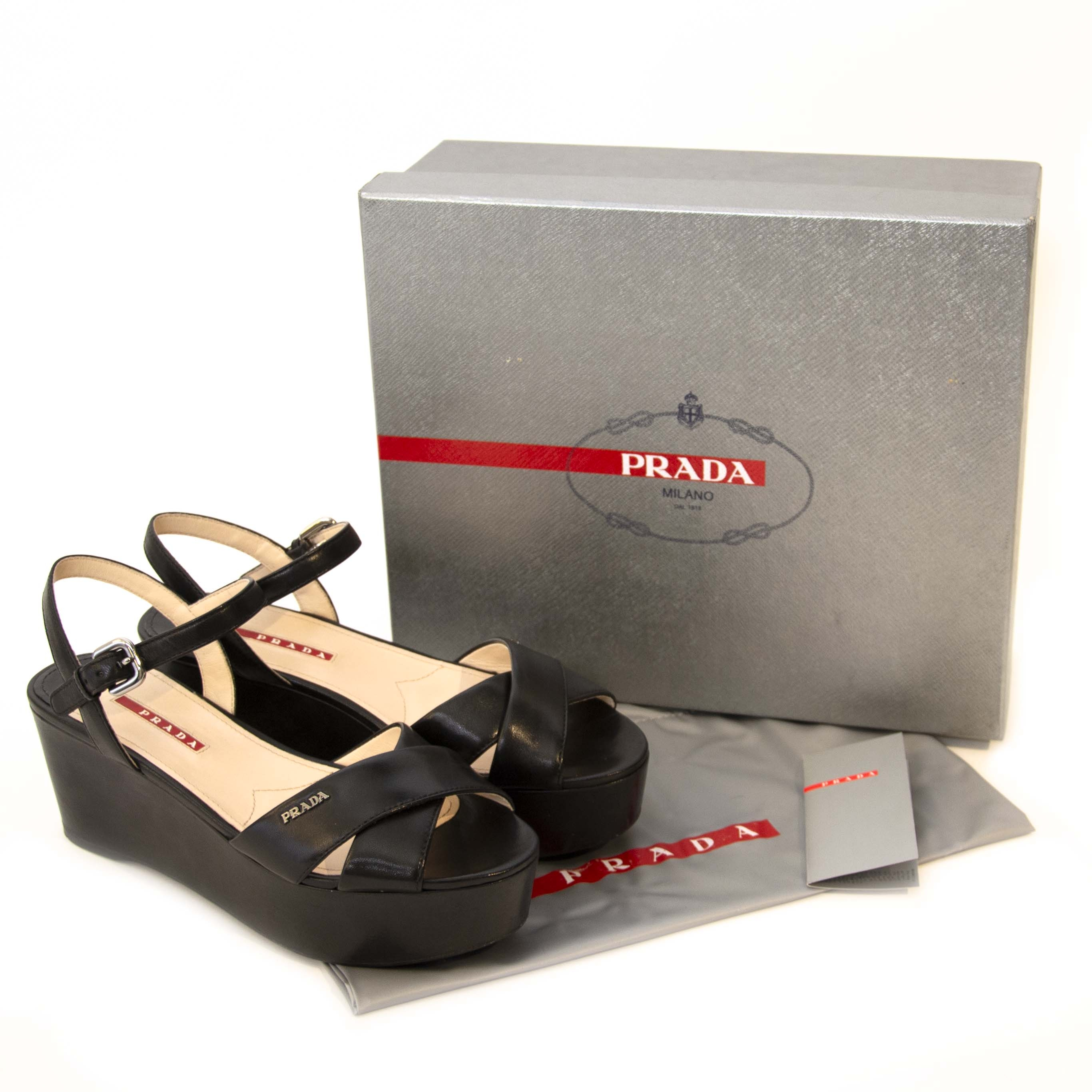 Prada Black High Platform Sandals - Size 38 Buy secondhand Prada shoes at Labellov. Safe online shopping at a fair price. Koop tweedehands Prada schoenen bij Labellov. Veilig online winkelen voor een eerlijke prijs.