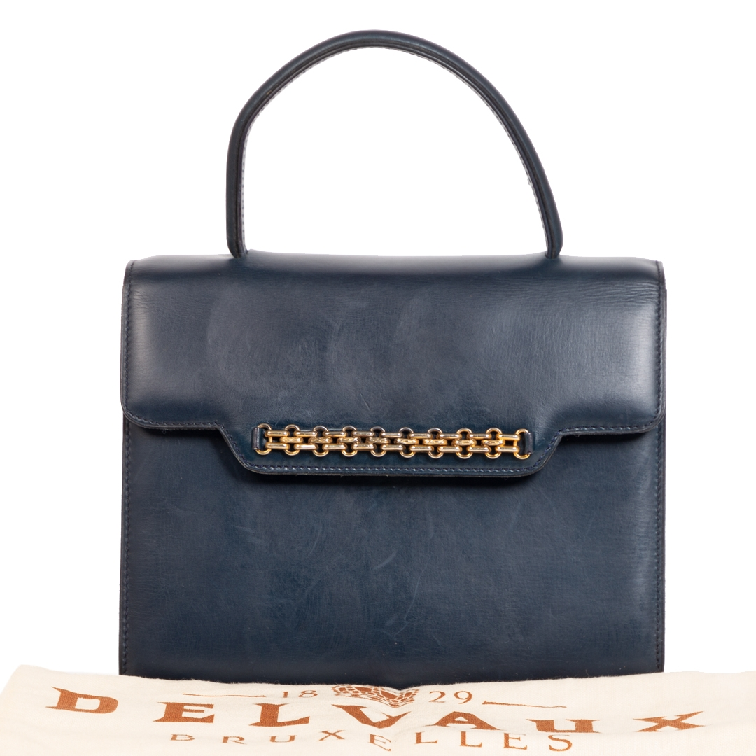 Are you looking for an authentic Delvaux Vintage Blue Top Handle Bag?