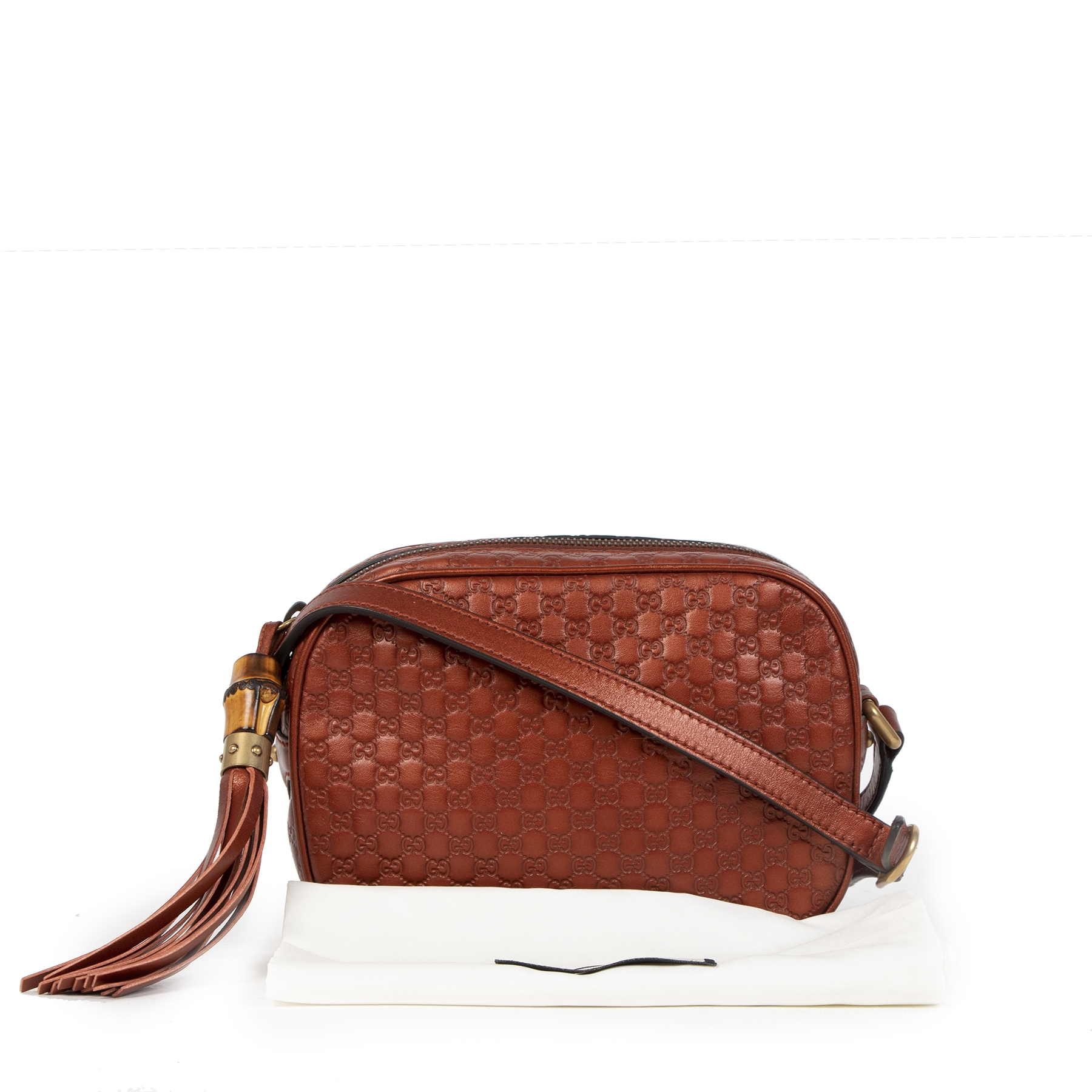 we buy and sell your designer bags online at Labellov Gucci Bronze Metallic Microguccissima Sunshine Crossbody Bag