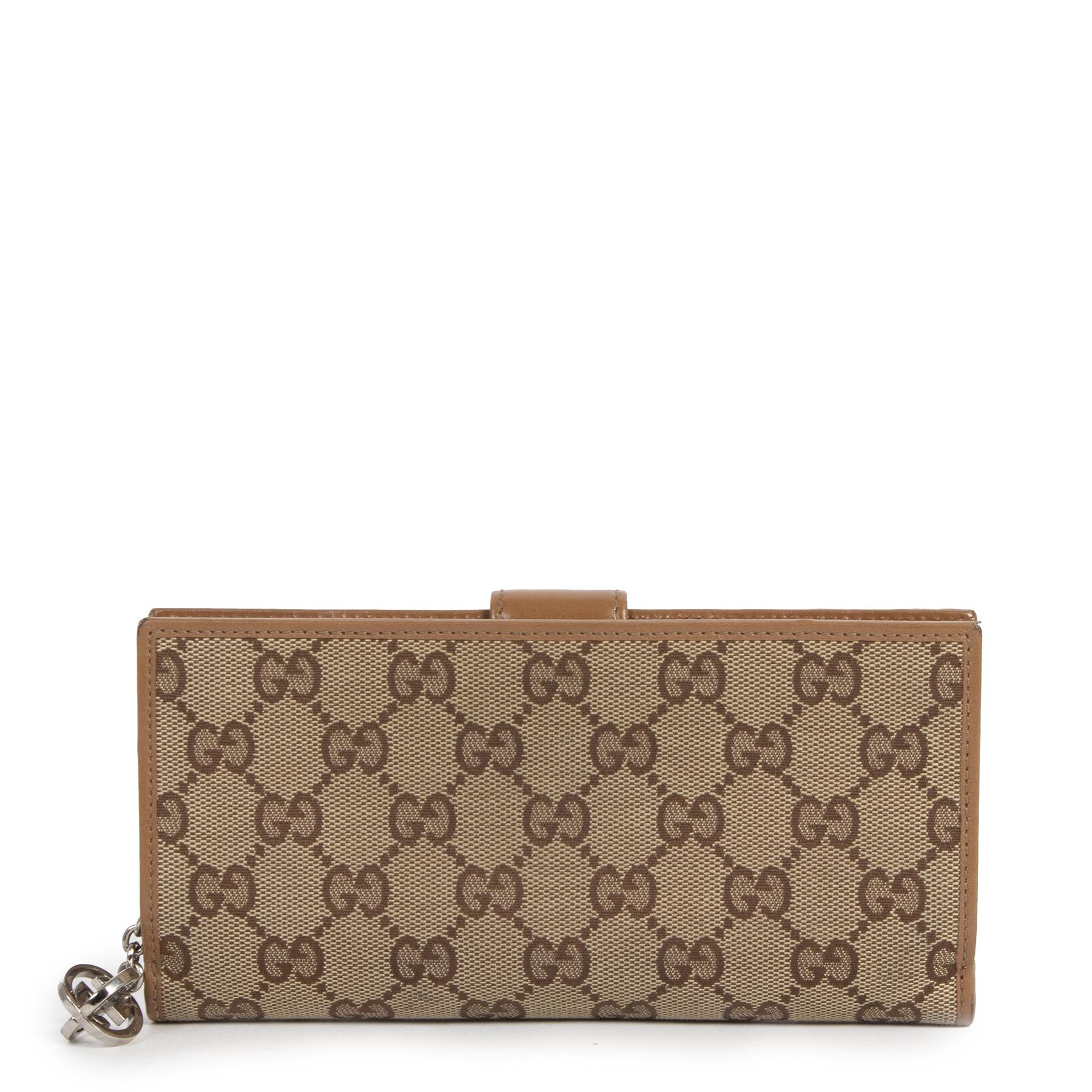 Koop veilig online authentieke tweedehands Gucci portefeuilles met de juiste prijs bij LabelLOV.