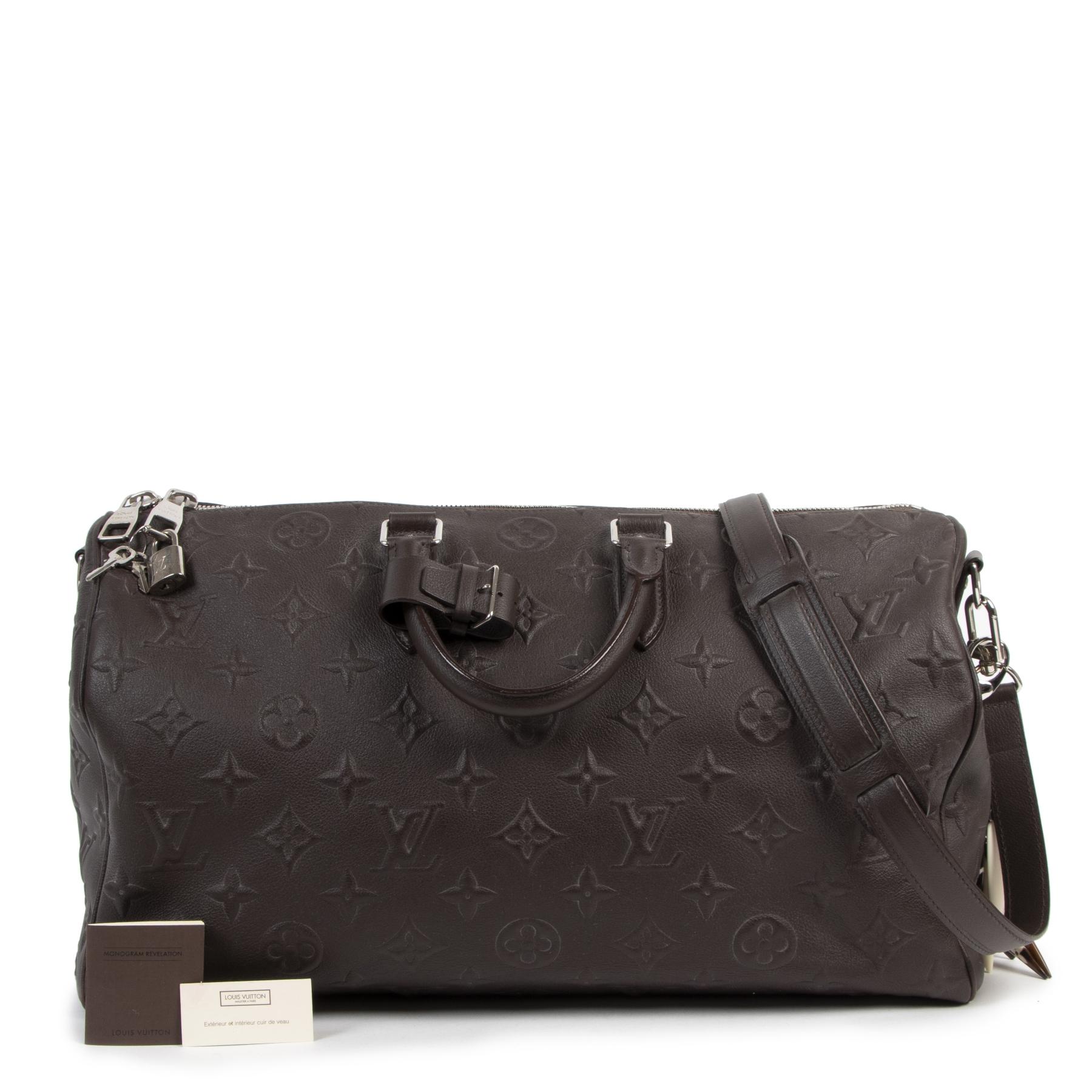 Authentic secondhand Louis Vuitton Monogram Révélation Keepall 45 designer bags fashion luxury vintage webshop safe secure online shopping