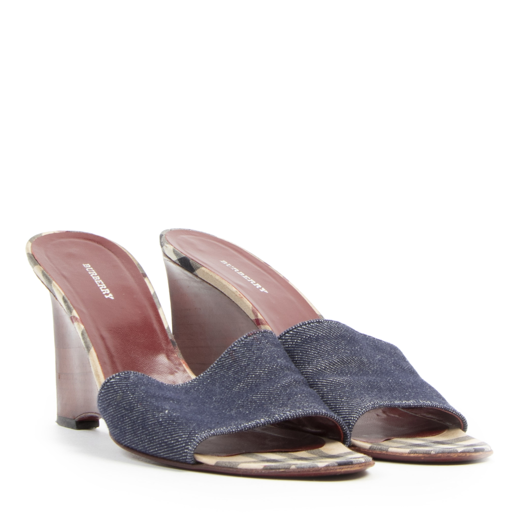 Are you looking for an authentic designer Burberry Wooden Slide On Heels - Size 40