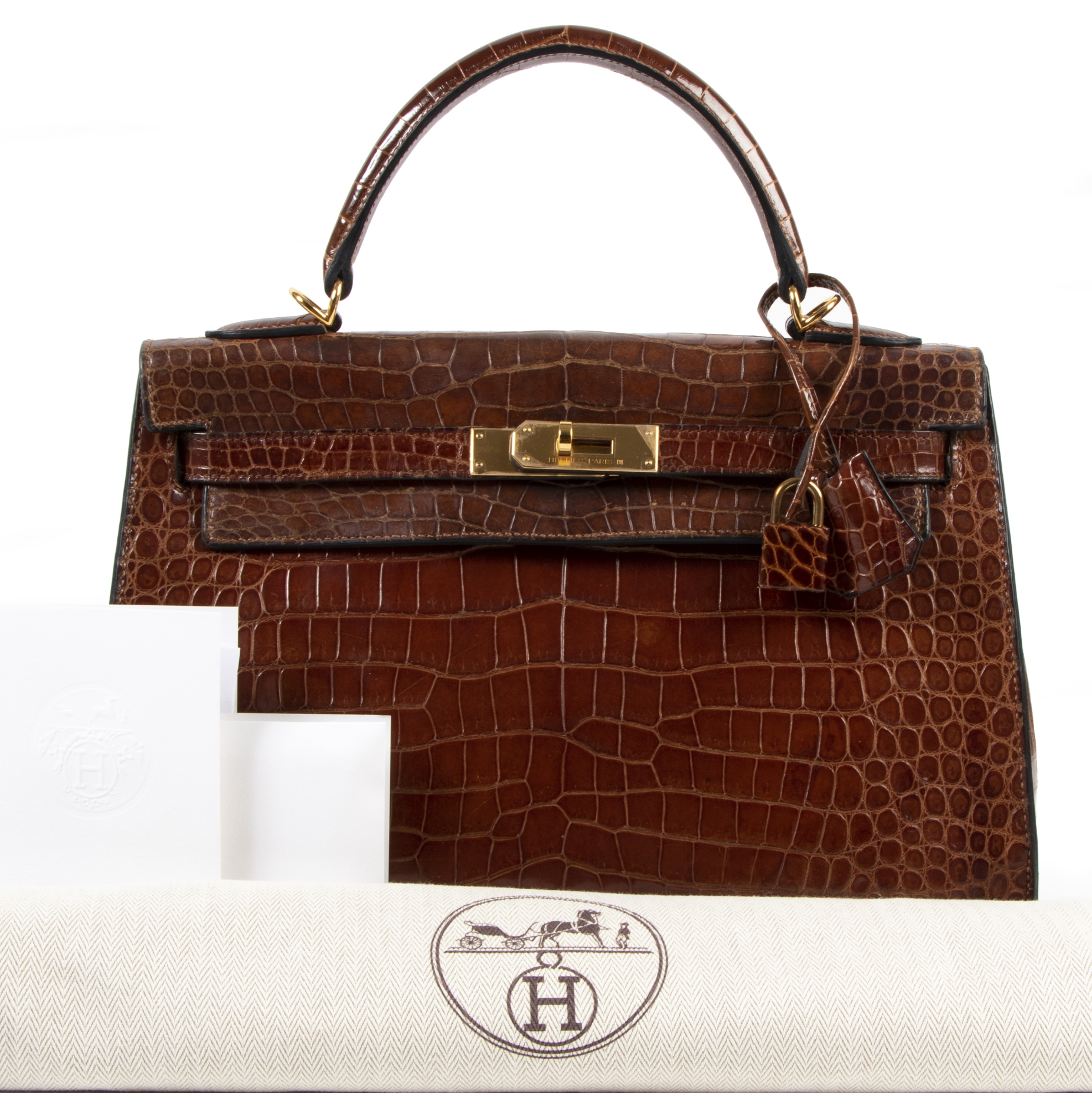 Buy and sell preloved designer vintage Hermès Kelly 32 Miel Crocodile GHW