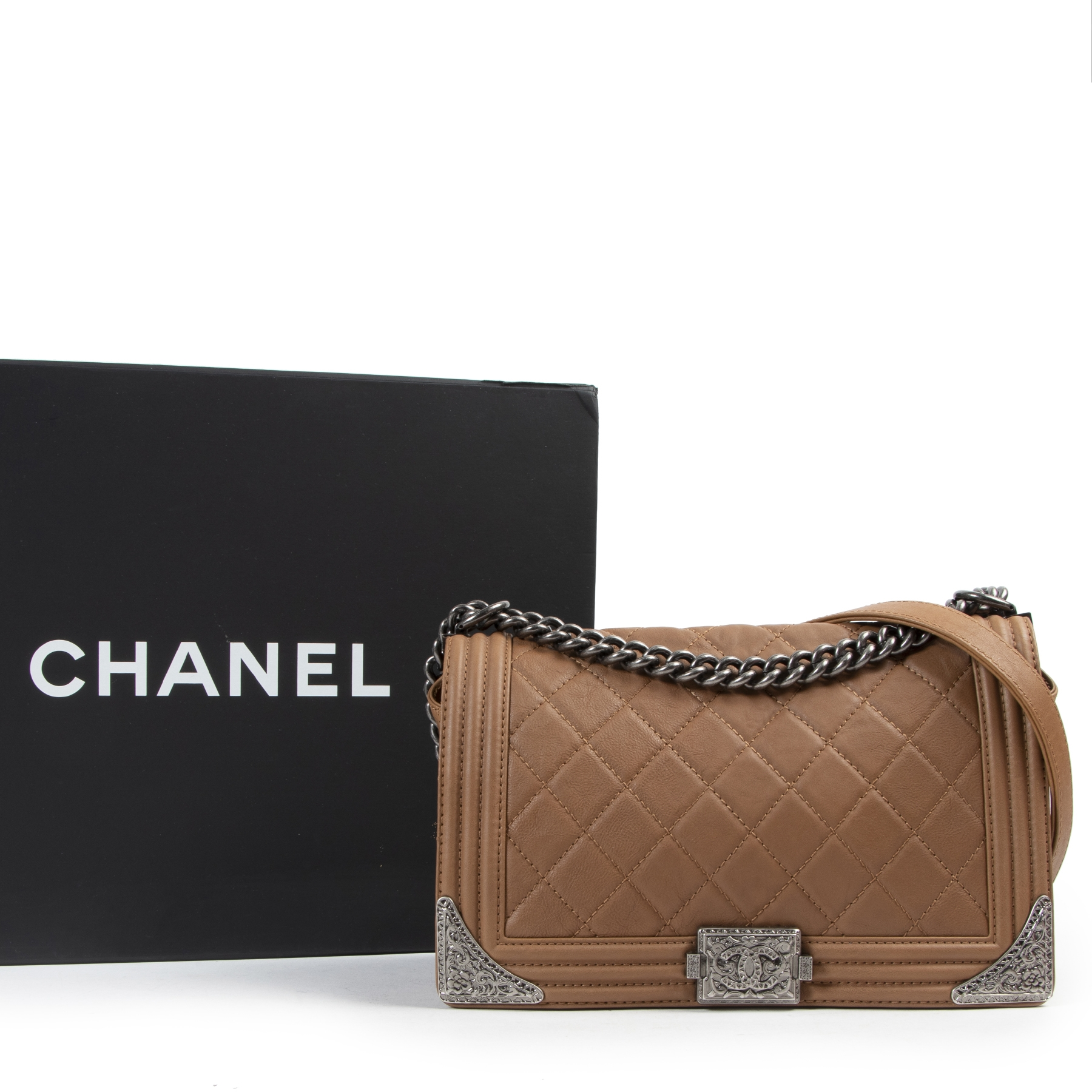 Are you looking for an authentic designer Chanel Tan Paris Dallas Metiers D'art Western New Medium Boy Bag?
