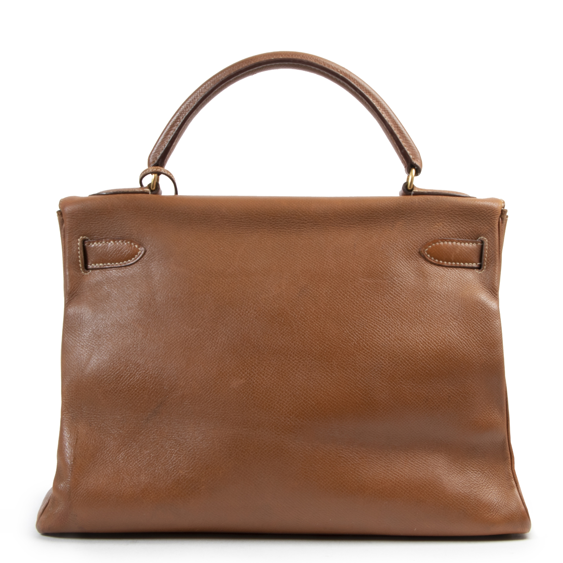 Buy this authentic second-hand vintage Hermès Kelly 32 Epsom Cognac at online webshop LabelLOV. Safe and secure shopping. Koop deze authentieke tweedehands vintage Hermès Kelly 32 Epsom Cognac bij online webshop LabelLOV.