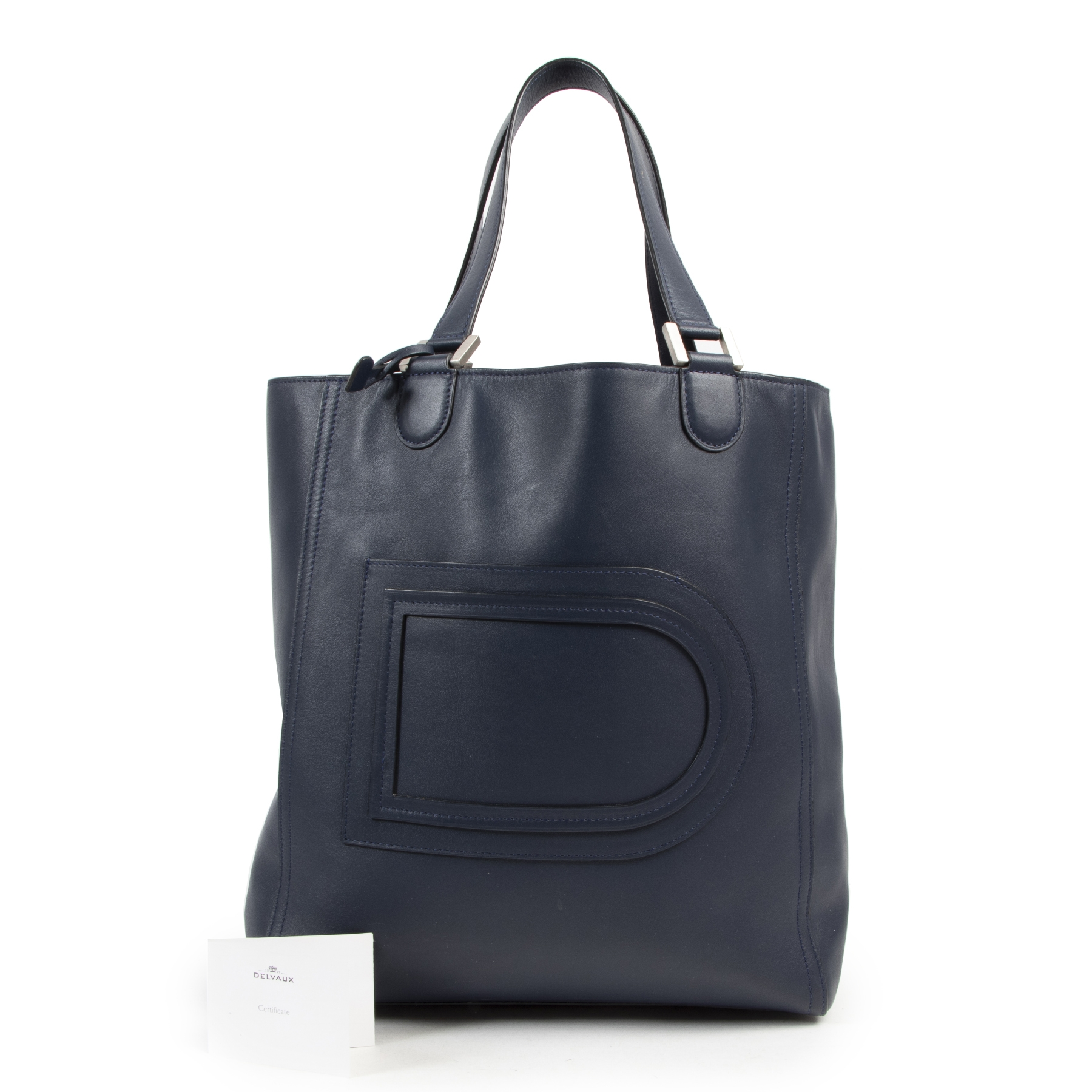 Delvaux Navy Tote Shoulder Bag. Authentieke tweedehands Delvaux handtassen bij LabelLOV Antwerpen. Authentique seconde-main luxury en ligne webshop LabelLOV. Authentic preloved Delvaux handbags at LabelLOV Antwerp.