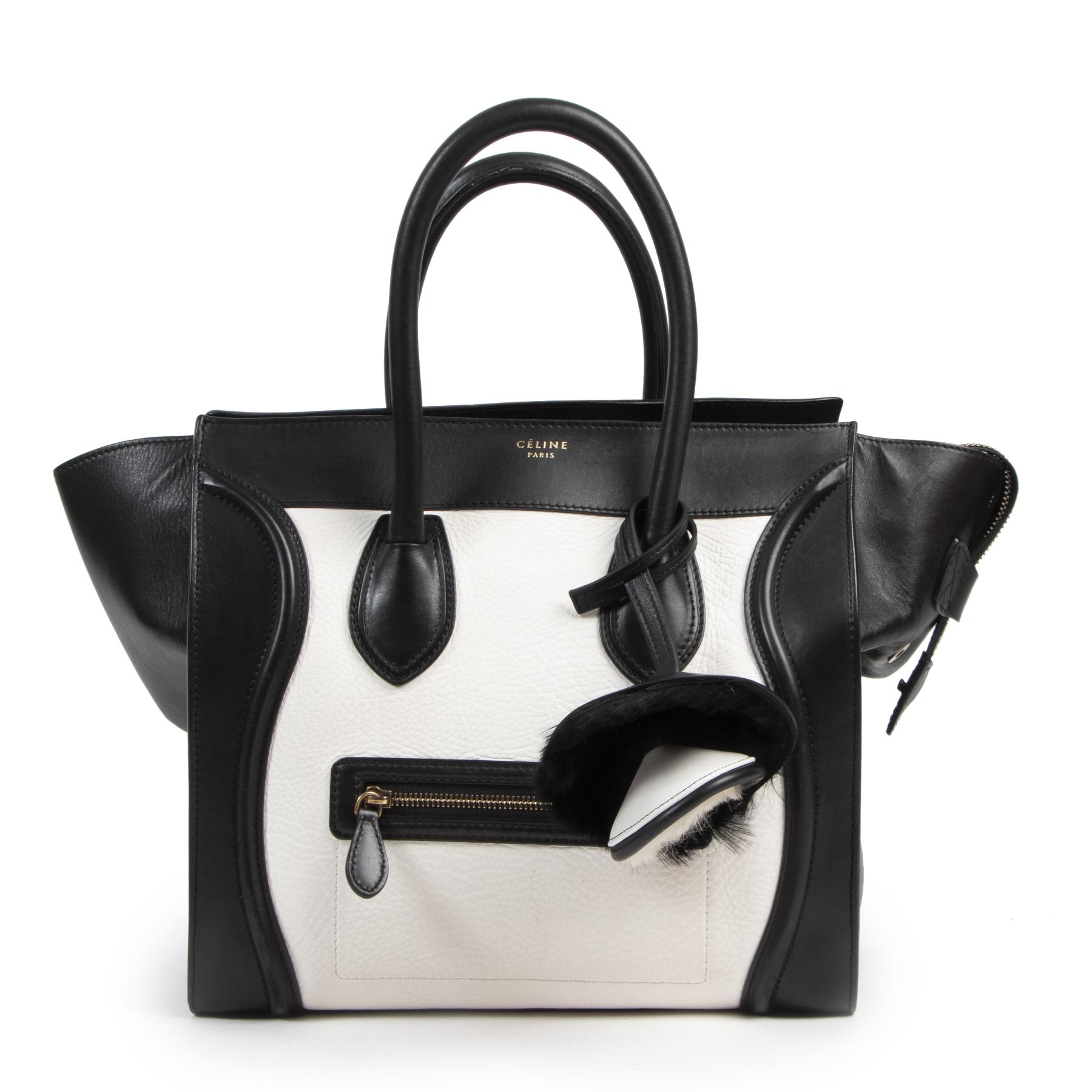 Céline Black and White Fur Bag Charm. Authentieke Céliné accessoires bij LabelLOV Antwerpen. Authentique luxury en ligne webshop LabelLOV. Authentic Céline accessories at LabelLOV Antwerp.