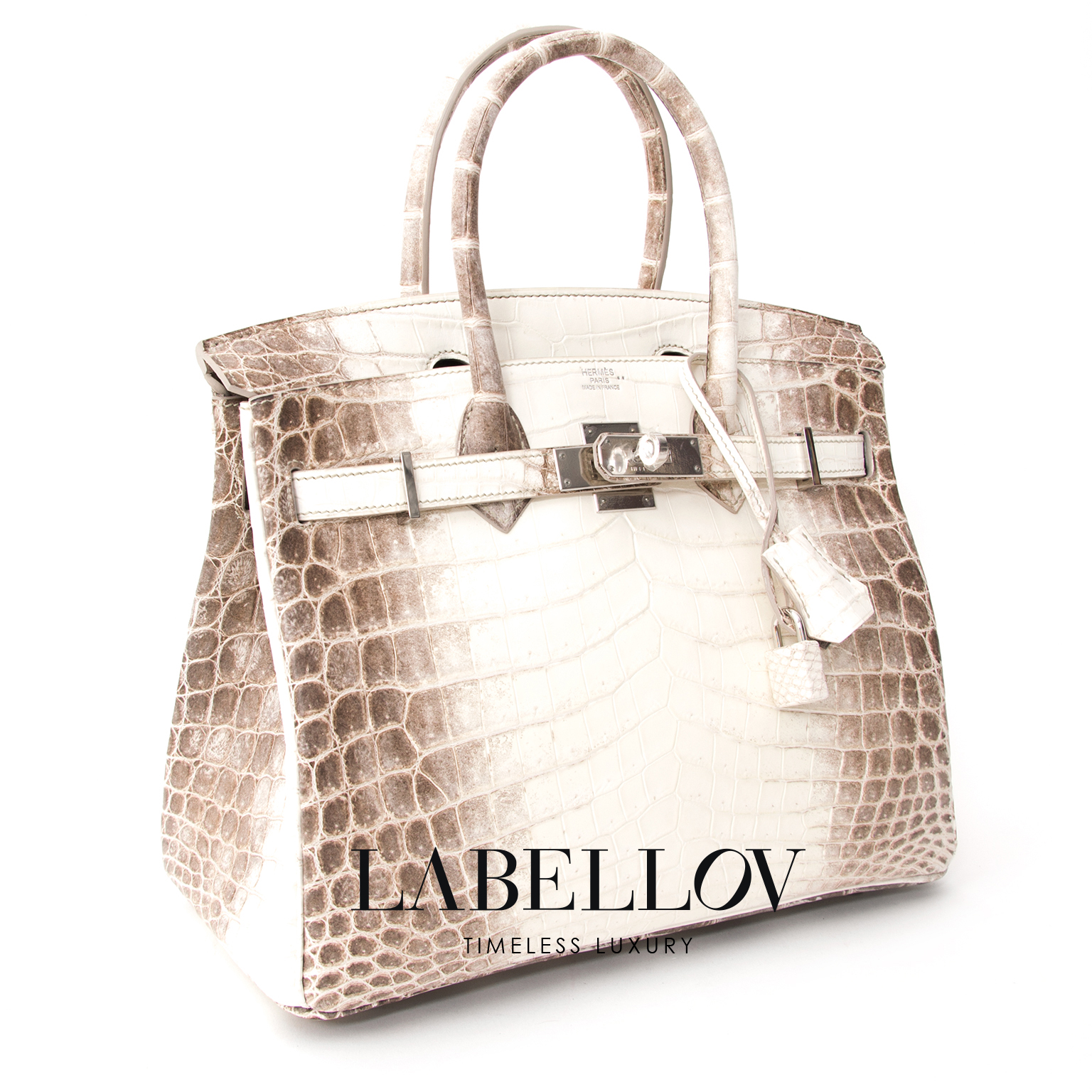 Made from the rarest albino Crocodile Niloticus hide with dyed sides in Himalayan brown.  This exquisite Hermès Birkin bag has an very practical and elegant size - it measures 30cm - and its coloration is is meant to evoke images of the majestic Himalayan