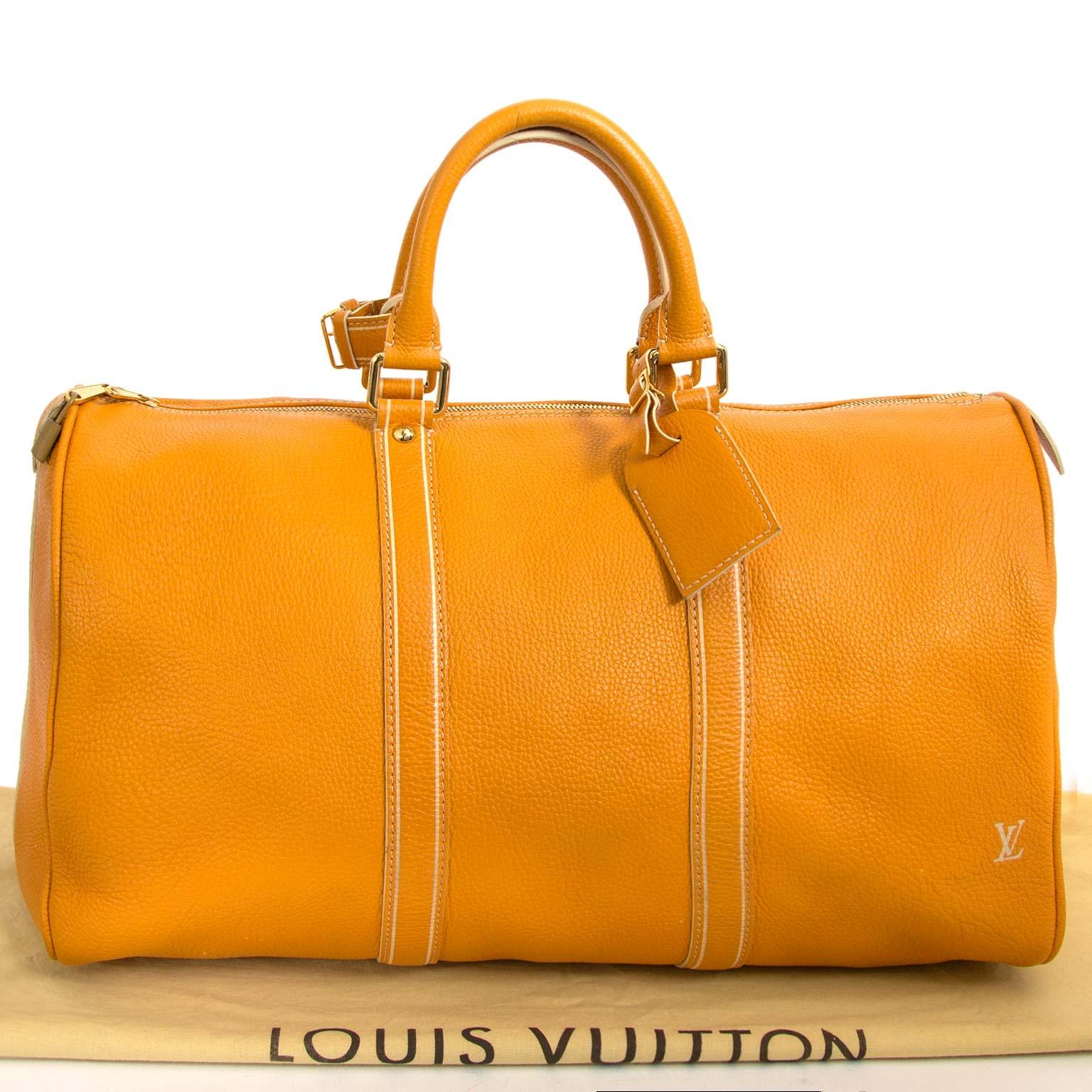 acheter en ligne seconde main Louis Vuitton Keepall Tobago Yellow Runway Travel Bag