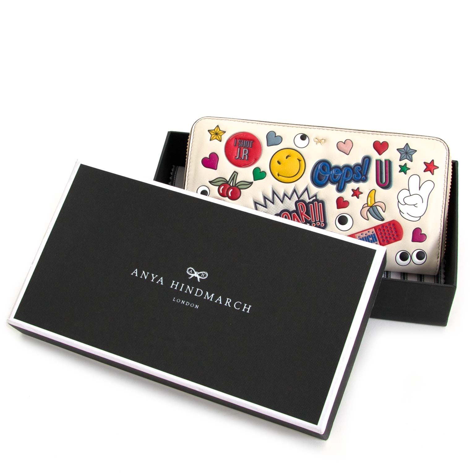 anya hindmarch large zip round wallet wink stickers now for sale at labellov vintage fashion webshop belgium