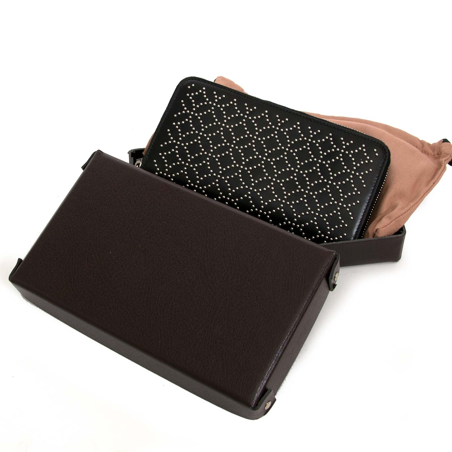 Alaïa Studded Zip Round Arabesque Wallet now for sale at labellov vintage fashion webshop belgium