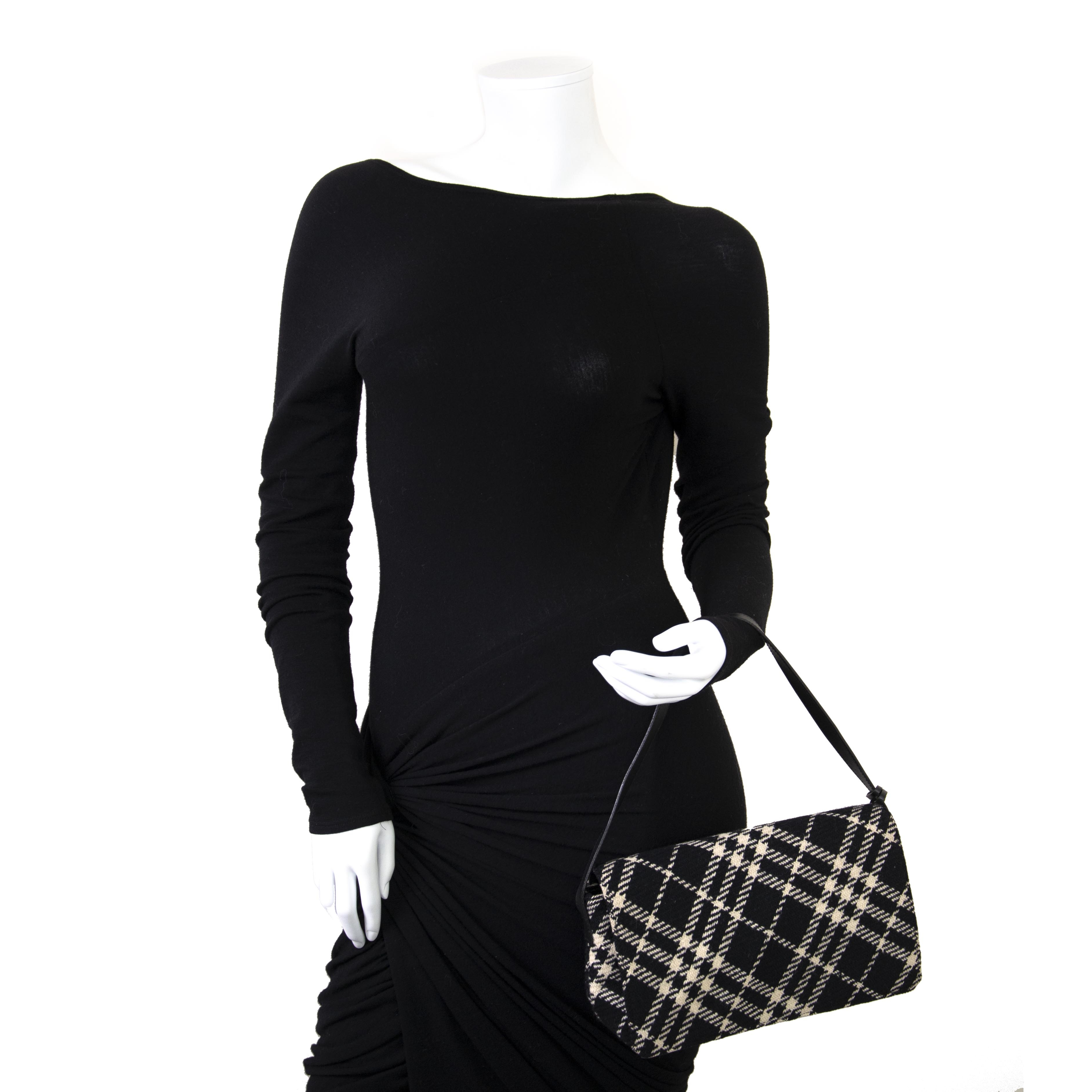 We buy and sell your authentic Burberry Black White Checked Wool Bag