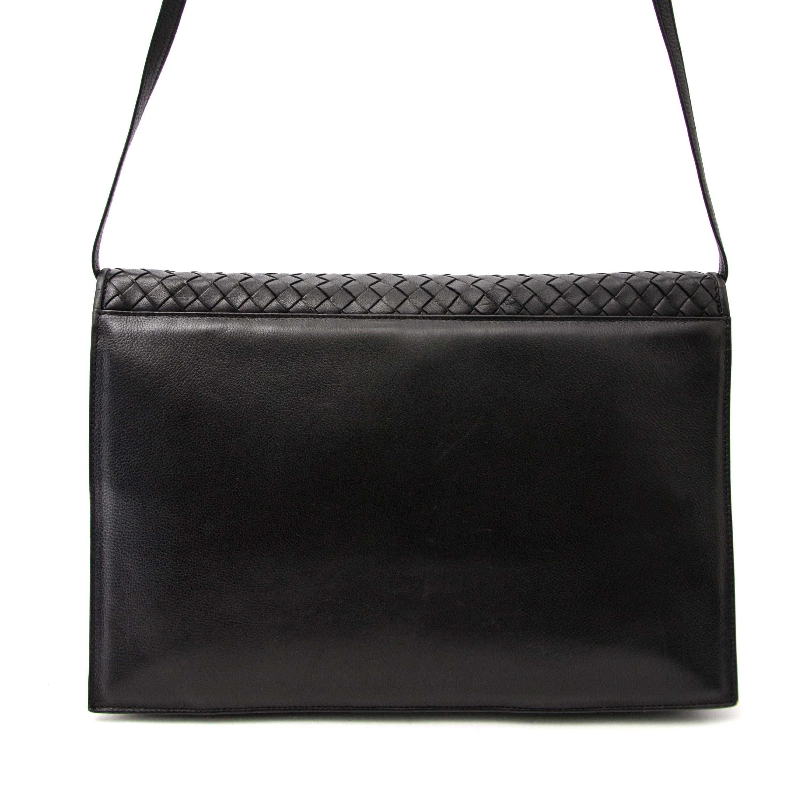 celine black woven leather clutch bag now online at labellov.com
