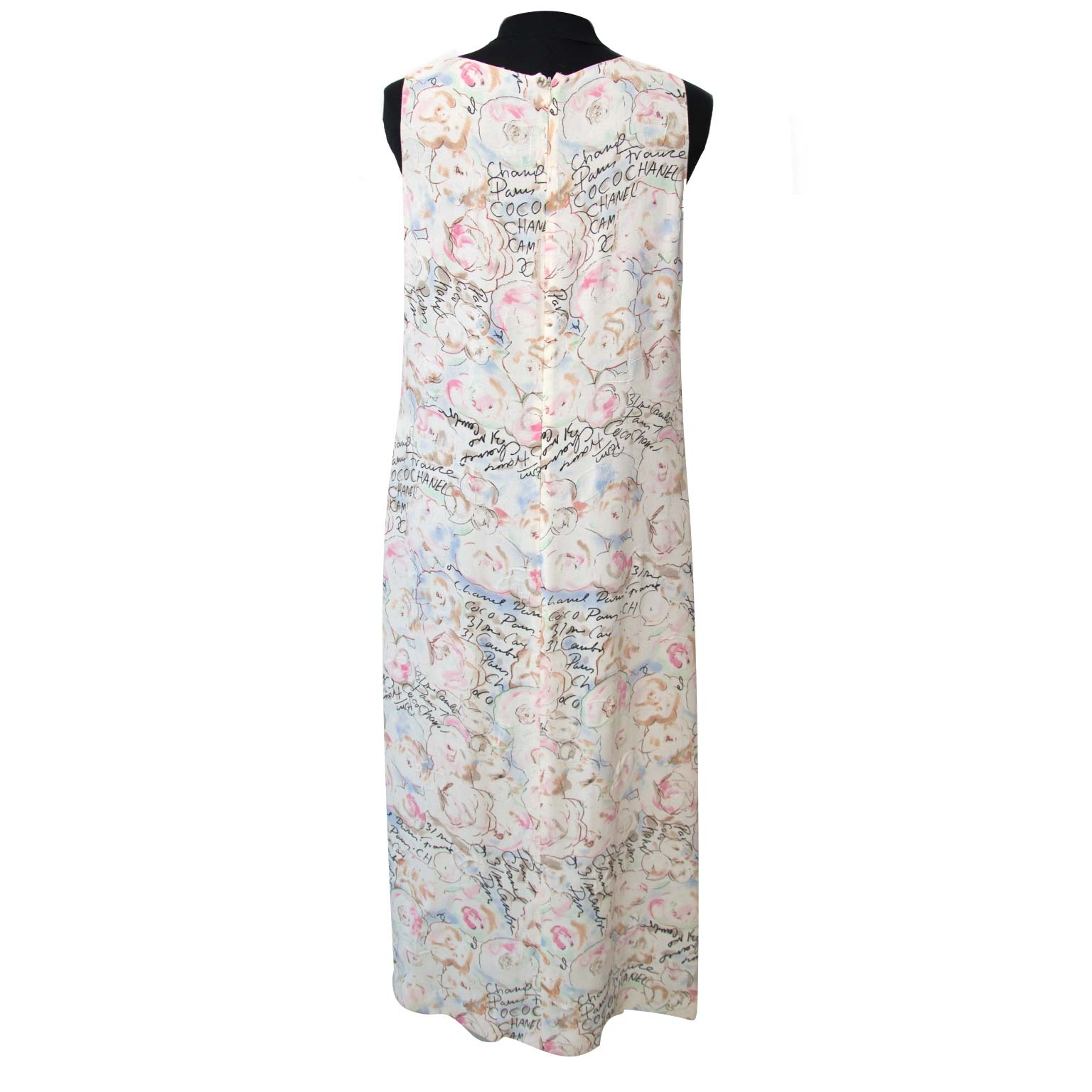 Chanel Pastels Floral Text Dress - Size 40  Buy authentic designer Chanel secondhand clothes at Labellov at the best price. Safe and secure shopping. Koop tweedehands authentieke Chanel kleding bij designer webwinkel labellov.