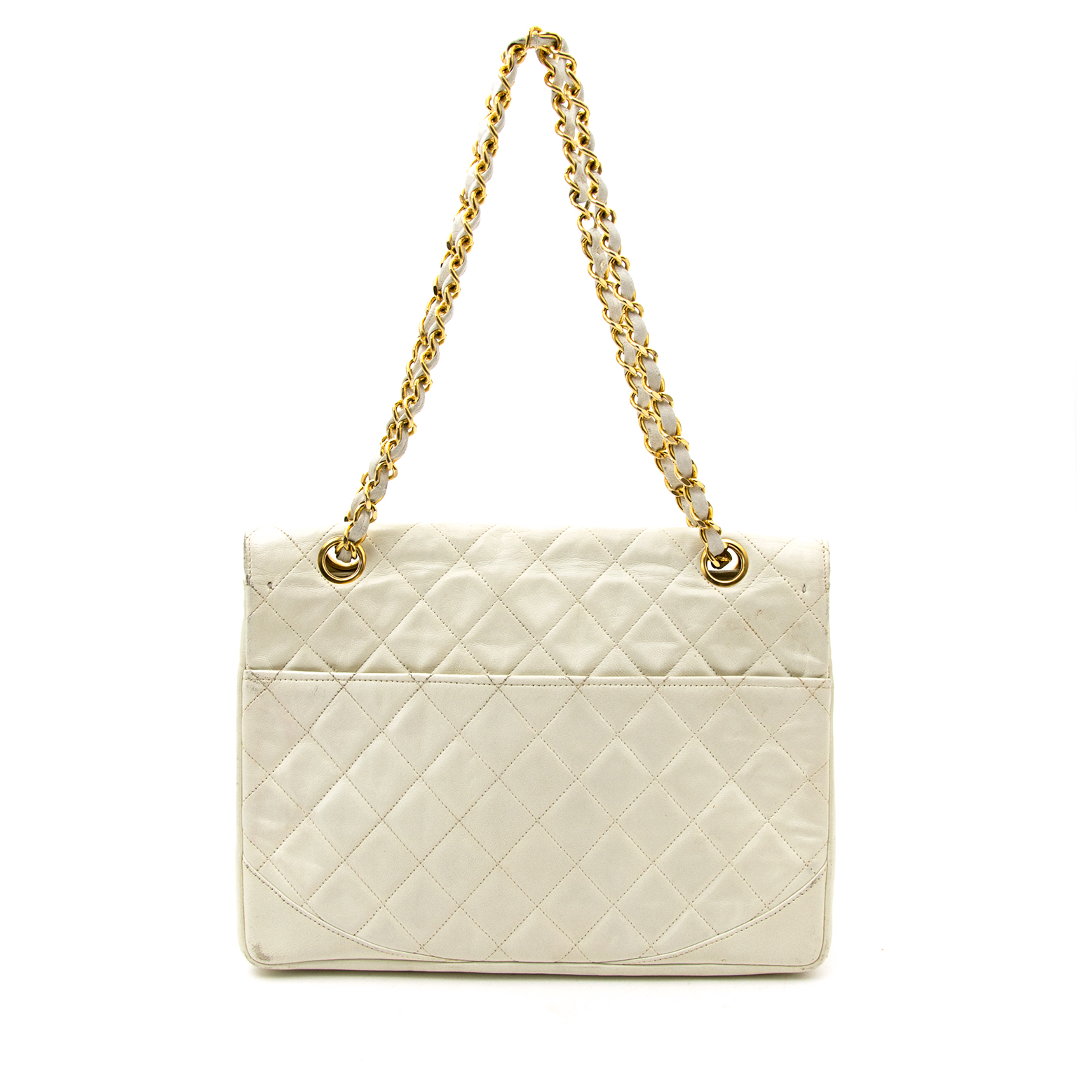 Buy this secondhand Chanel White Vintage Flapbag at the right price