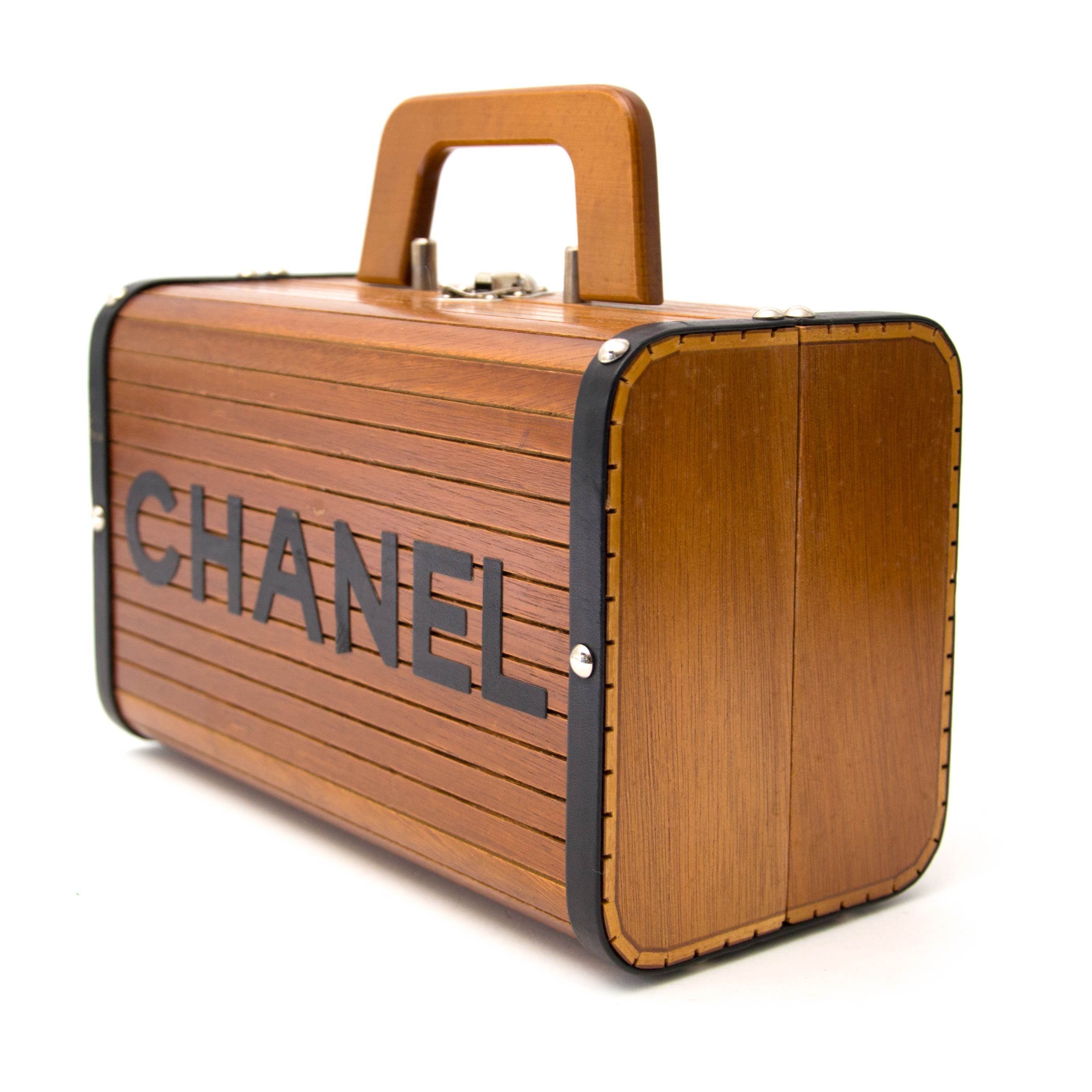 searching for a luxury Chanel Limited Wooden Leather Trunk Case Handbag online?
