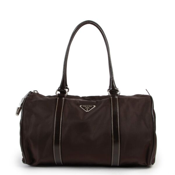 Buy and sell designer items at Labellov Luxury. Get this Prada Brown Nylon Duffle Bag online or in the showroom in Antwerp.