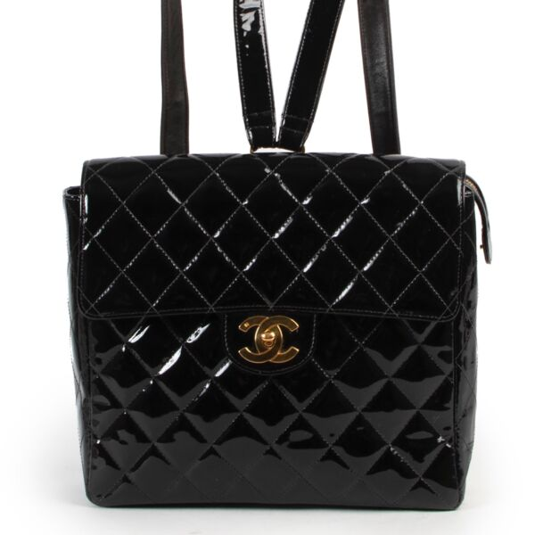 Shop safe online 100% authentic second hand Chanel Black Quilted Patent Leather Backpack at Labellov in Antwerp.