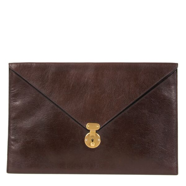 Beautiful second hand clutch from Delvaux in dark brown.