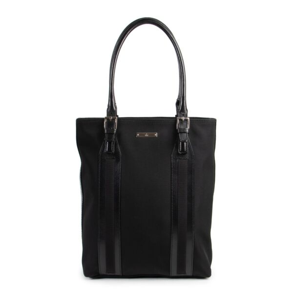 Buy a Gucci nylon black bag second hand that will fit a laptop. The perfect office bag.