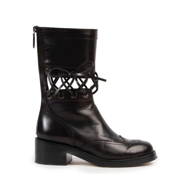 koop veilig online tegen de beste prijs CHANEL COMBAT BOOTS
