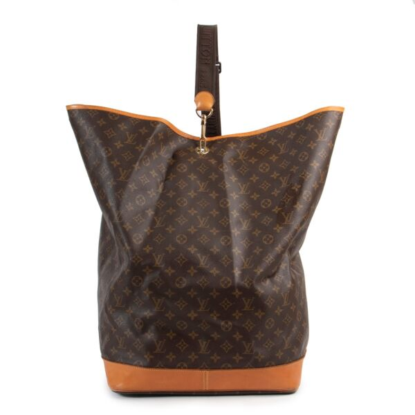 Buy this second hand Louis Vuitton Monogram Sac Marin Travel Bag safely online.