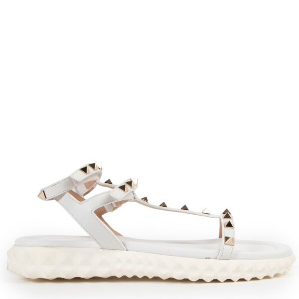 Wear these Valentino White Free Rockstud Gladiator Sandals - Size 37 during summer, so get them now at Labellov online or in store.