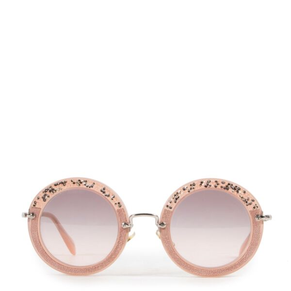 Shop safe online 100% authentic second hand Miu Miu Pink Sunglasses in very good condition at Labellov in Antwerp.
