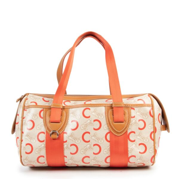 Buy and sell your secondhand designer items for a reasonable price at Labellov Antwerp, come by in store or online. Buy this Céline C Macadam Shoulder Bag Beige Orange Canvas for a reasonable price in very good condition.