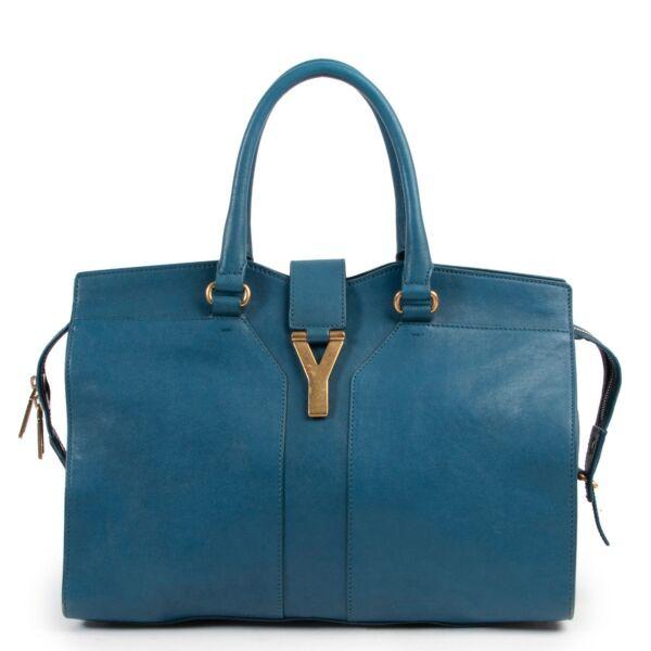 Online kopen van een tweedehands Yves Saint Laurent blauwe handtas bij Labellov