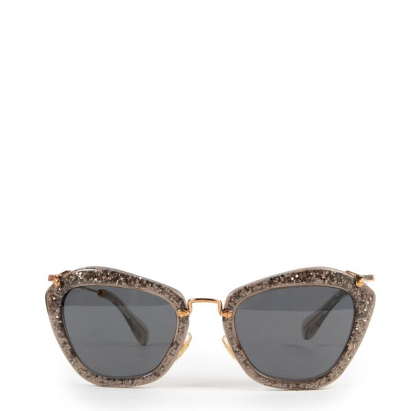 Miu Miu Noir with Golden Glitter Sunglasses Buy this unique piece here safely!