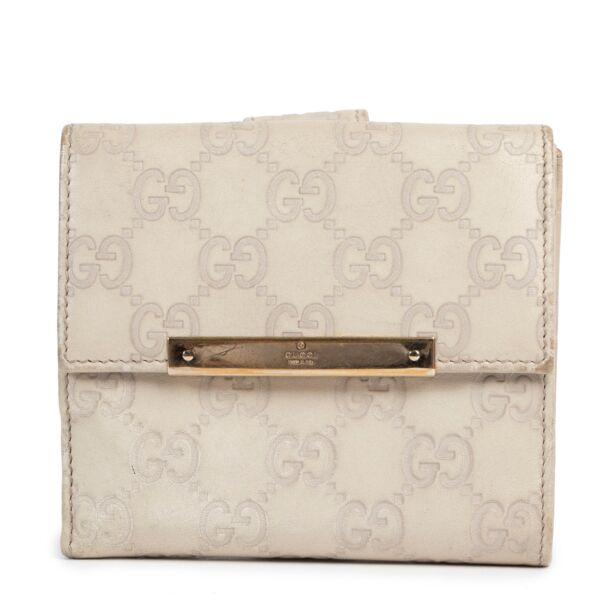 Acheter en ligne portefeuille de Gucci en beige.