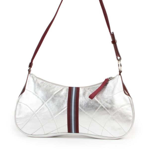 Buy and sell your authentic designer items at Labellov in store or online such as this Prada Shoulder Nappa Matelasse Bag Argento.