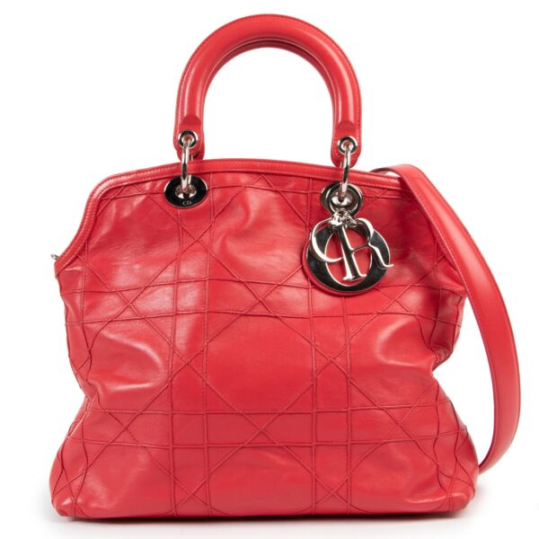 Christian Dior Dark Pink Cannage Quilted Lambskin Shoulder Bag  All of the iconic features of the classic Dior IT-Bag 'Lady Dior' combined into a contemporary tote - this Christian Dior Dark Pink Cannage Quilted Lambskin Shoulder Bag is a must-have for
