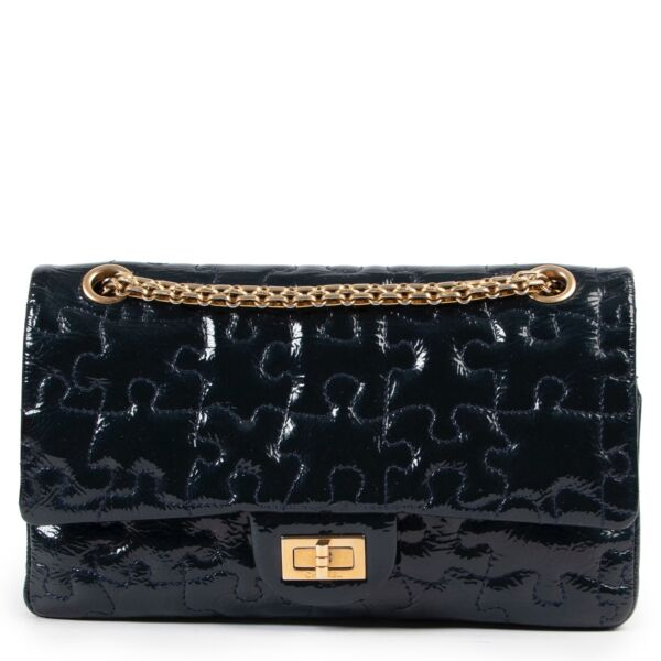 Shop safe online at Labellov in Antwerp this 100% authentic second hand Chanel Blue Patent Reissue 2.55 Puzzle Bag