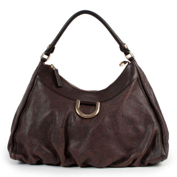 Burberry Vintage Check Baseball CapGucci brown leather bag with shoulder strap