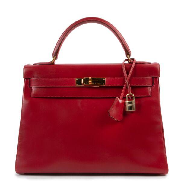 Shop safe online 100% authentic second hand Hermès Kelly Retourne 32 Smooth Red Veau Tadelakt Calfskin GHW at Labellov in Antwerp.