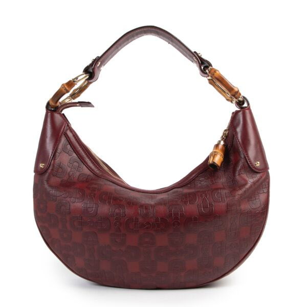 Shop safe online or in store at Labellov for a reasonable price of designer items. This Gucci Burgundy Horsebit Bamboo Ring Moon Hobo Bag is available at Labellov.