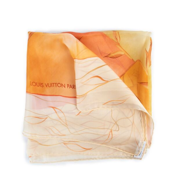Buy and sell your authentic designer accessories such as this Louis Vuitton Pink Orange Airplane Scarf only at Labellov secondhand luxury in Antwerp.