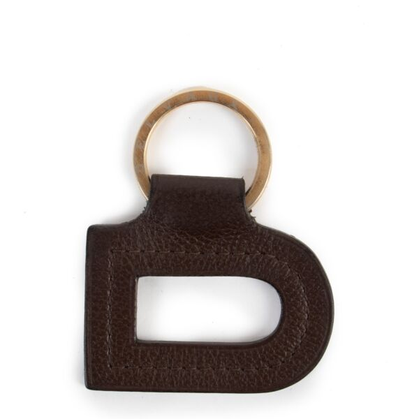 """Delvaux Brown Leather """"D"""" Keychain You can now buy this gorgeous Delvaux piece here safely!"""