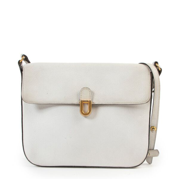 White leather cute Delvaux bag with shoulder strap in preloved condition