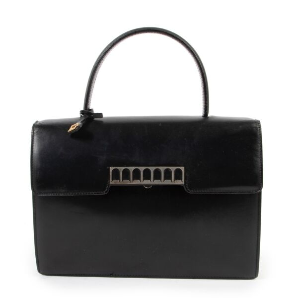 Buy this Delvaux Vintage Black Top handle if you are a vintage lover for a reasonable price at Labellov Antwerp online or in store.