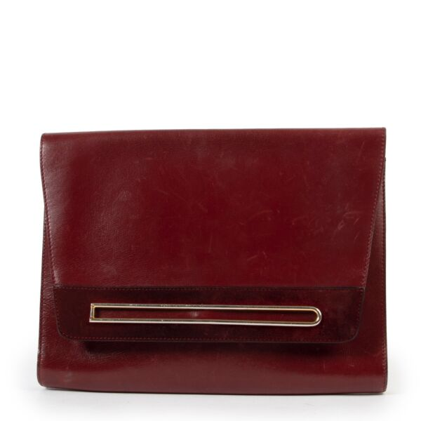 Original vintage 2nd hand Delvaux Burgundy Leather Clutch in good condition on Labellov website now for sale
