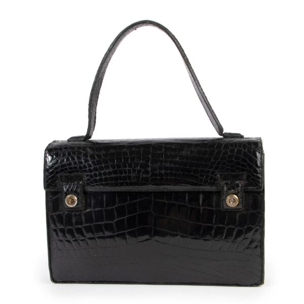 Delvaux Black Croco Vintage Top handle available at Labellov. A true vintage catch for vintage lovers online or in store.
