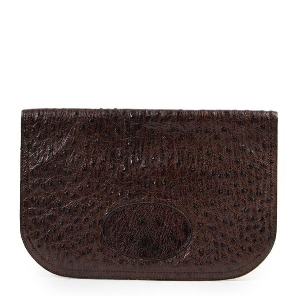 Shop safe online 100% authentic second hand Delvaux Brown Ostrich Pochette at labellov in Antwerp.