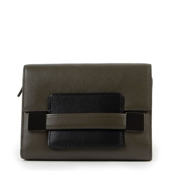 Shop and sell authentic second hand Delvaux Madame Bicolour Compact Wallet at Labellov for the best price