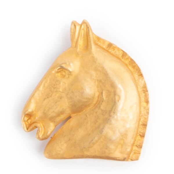 By an authentic second hand Hermès Horse Head Brooch at Labellov