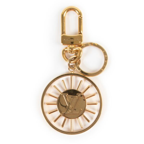 Shop safe online at Labellov in Antwerp this 100% authentic second hand Louis Vuitton Gold Bag Charm/Key Chain