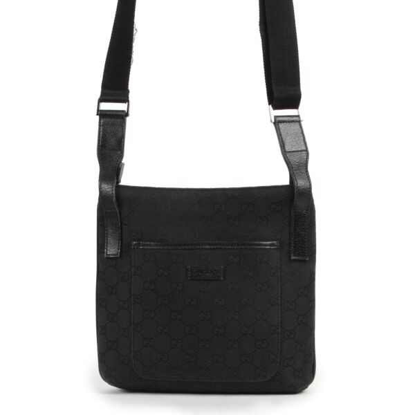 Gucci Black GG Canvas Messenger Crossbody Bag now available for selling online or in store at Labellov Luxury