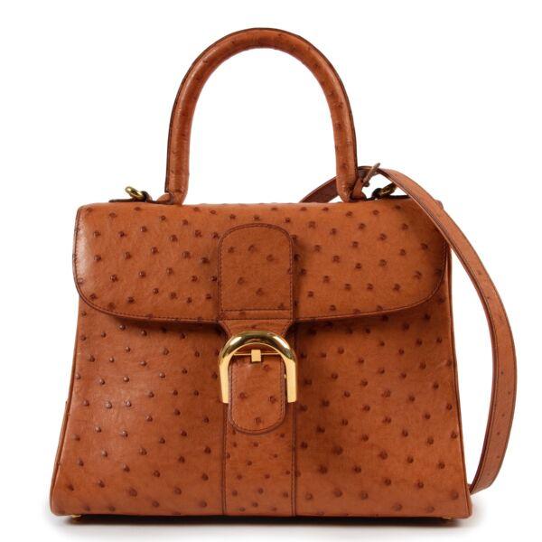 Shop safe online at labellov in Antwerp this 100% authentic second hand Delvaux Cognac Ostrich MM Brillant + Strap